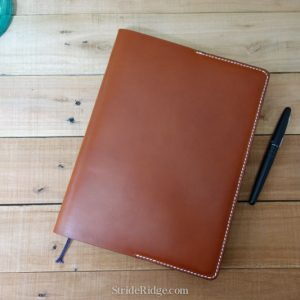 XL Moleskine Notebook cover chestnut leather and white stitching.