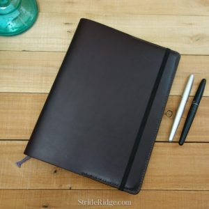 XL Moleskine Notebook cover dark brown leather and dark brown stitching.