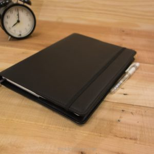 XL Moleskine Notebook cover black leather and black stitching.